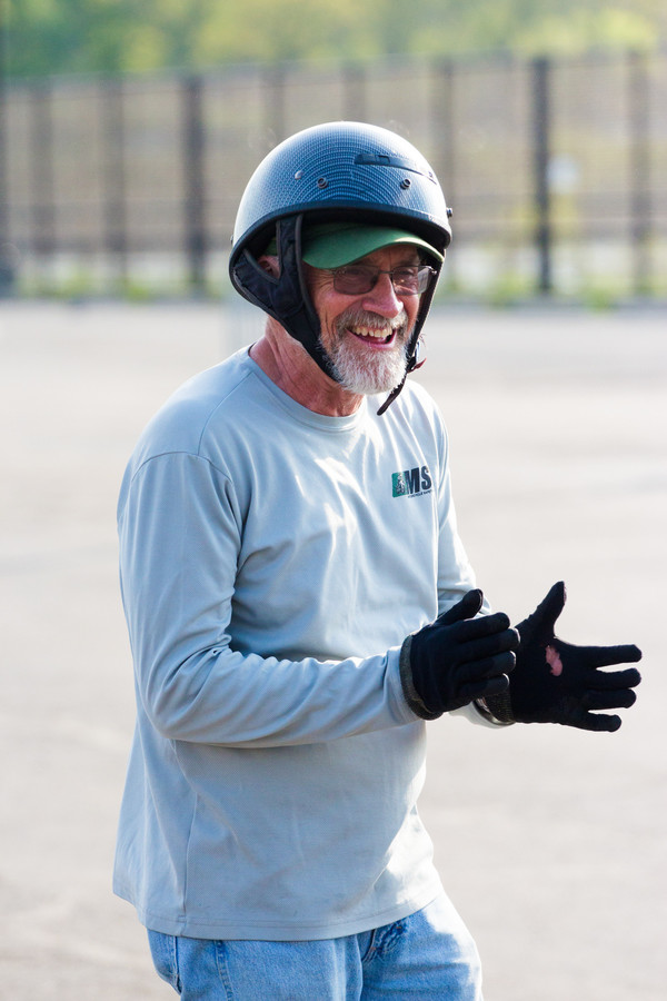 Instructor and motorcycle guru Jimmy Walsh applauds his students at Lehman College.