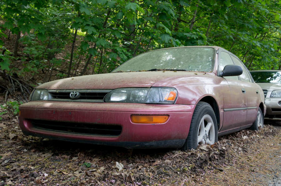 'Eye sore' and 'health hazard' were what residents called an abandoned red Toyota on Valles Avenue and Post Road on West 254th Street. The vehicle was covered in dirt and the wheels were caked with mud. The car was towed away one day after The Press began investigating the story.