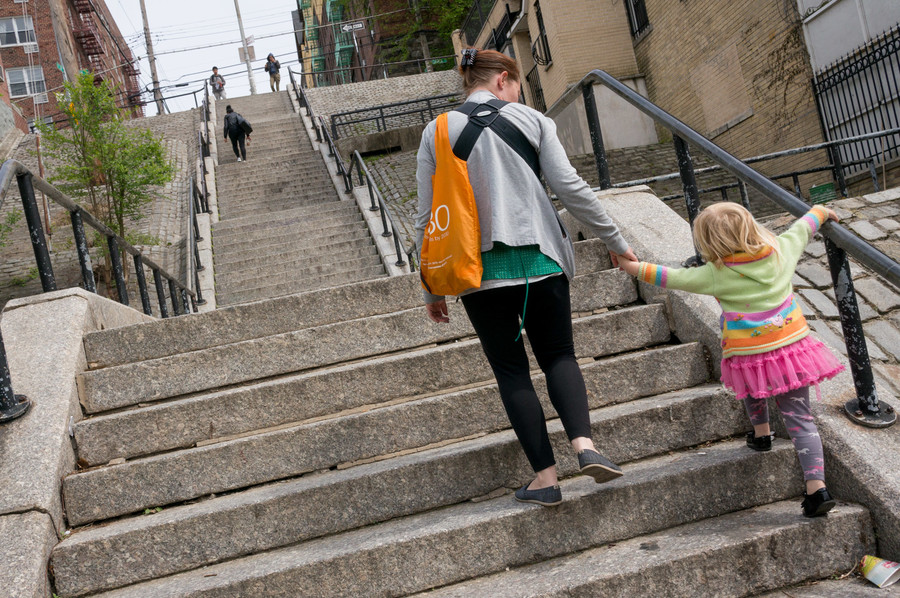 Residents ascend the step street on West 238th Street between Cannon Place and Orloff Avenue.