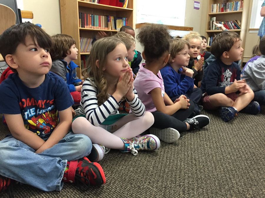 Pre-kindergarten students at Riverdale Neighborhood House take part in a read-a-thon. The community center celebrated the re-opening of its library by reading books and singing songs with students.
