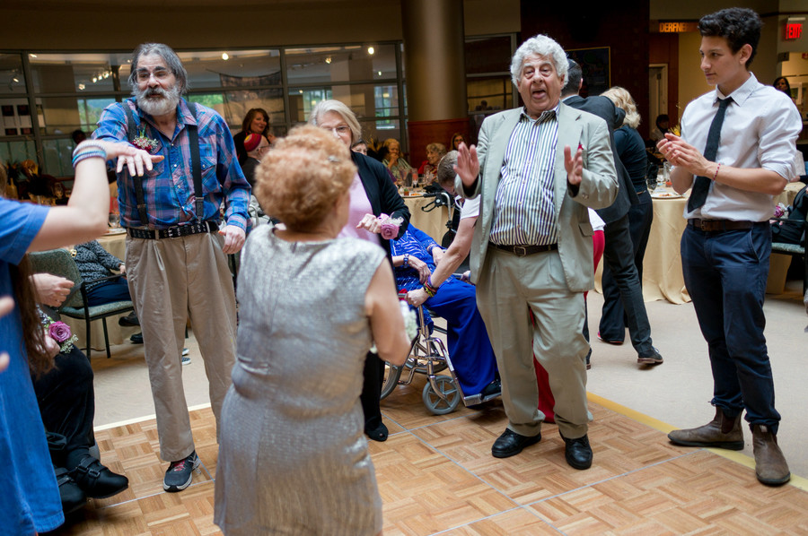 Victor Mastro, right, does the twist. He said the afternoon was a way to enjoy camaraderie and fun with his fellow residents.