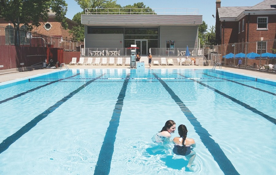 Emily Martin and Alana Knapp-Molina brave the cold pool water at Riverdale Neighborhood House at the start of summer a few years ago. The neighborhood house is forming a strategic partnership with the Riverdale Community Center to help combine some of its community-minded resources.