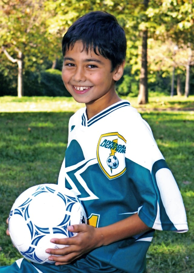 Remi Kumar, age 10, poses for his travel soccer team photo in Seton Park.