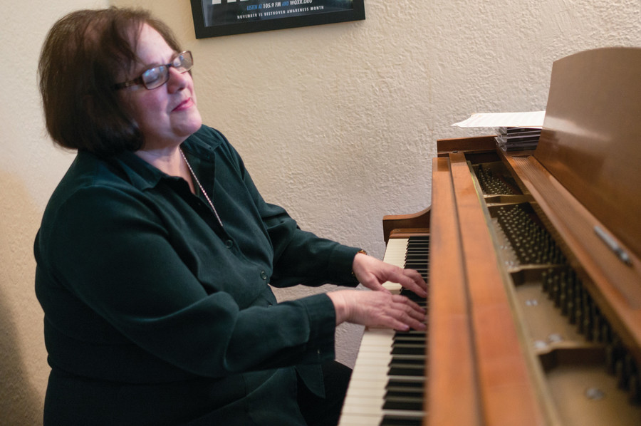 Penny Prince, a professor at Lehman College, plays the piano in her Riverdale home. She recently produced an adaptation of 'Rapunzel' at Lehman.