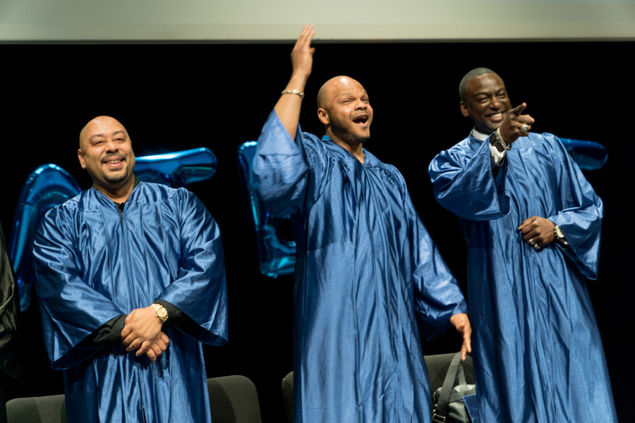 Raymond Santana, Kevin Richardson and Yusef Salaam cheer on stage before they received honorary high school diplomas from Bronx Prep Charter High School. They are three of the Central Park Five who were wrongfully convicted of a rape in 1990 and exonerated in 2002.