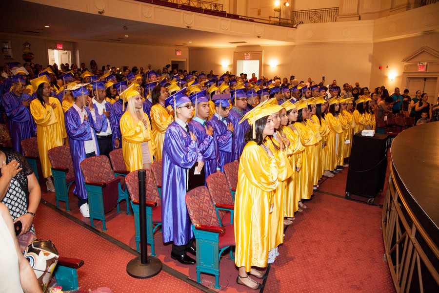 IN-Tech Academy students recite the Pledge of Allegiance during their commencement exercises on Saturday, June 24.