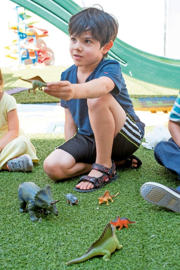 Ben talks about the finer points of dinosaurs at the Rodi Daycare Center.