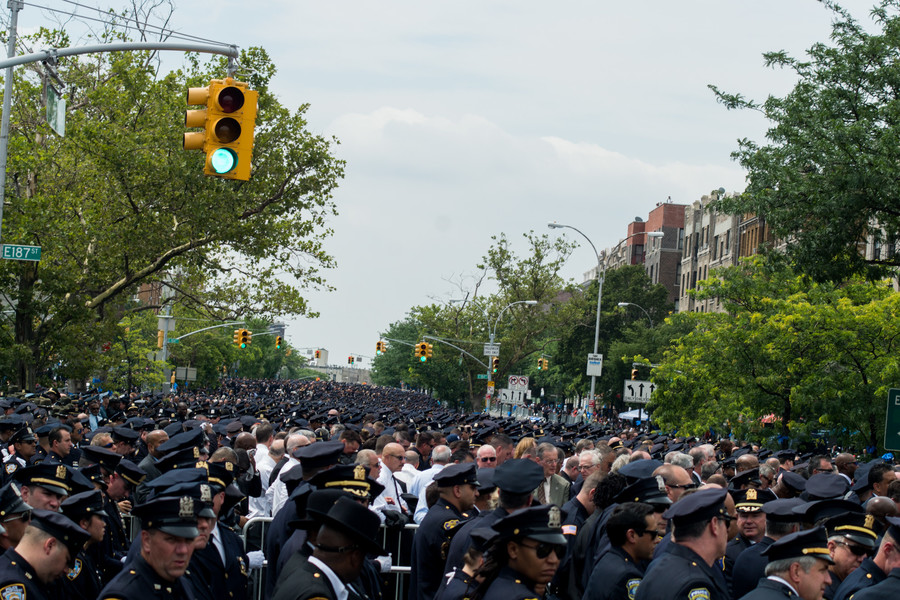 Police officers from across the city, the country and the world attended the funeral turning the Grand Concourse into a sea of blue hats.