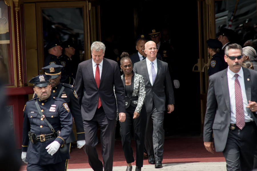 New York City Mayor Bill de Blasio and wife Chirlane McCray walk out of World Changers Church after the funeral of slain NYPD officer Miosotis Familia.