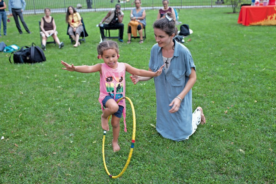 People learn different styles of dancing at a barefoot dancing class in Van Cortlandt Park.