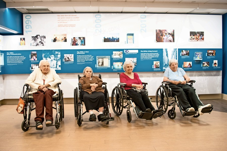 Residents of the Hebrew Home at Riverdale visit the assisted living facility's centennial exhibition.