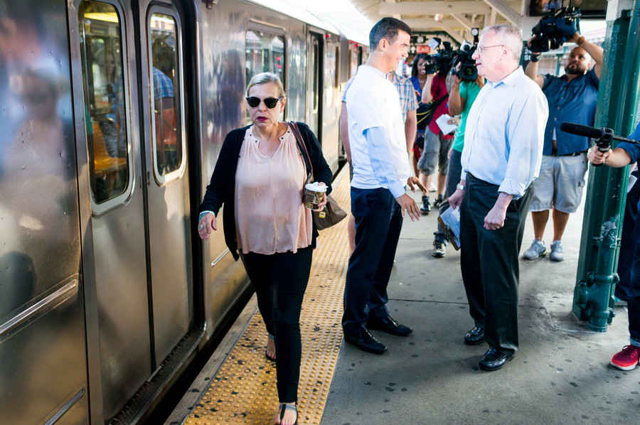 'Get the (expletive) out of my way!' a woman, left, yelled as she walked past Assemblyman Jeffrey Dinowitz and Councilman Ydanis Rodriguez, on the subway platform to talk to riders about problems with mass transit.