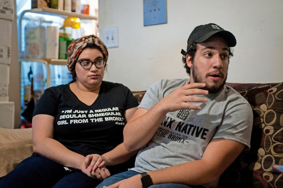Amaurys Grullon, right, talks about the making of Bronx Native with his sister Roselyn in their apartment in the South Bronx. The inspiration came to them after the two were unable to find clothing emblematic of what the Bronx means to them.
