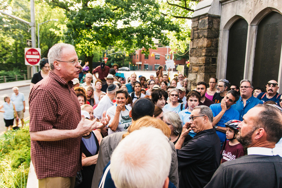 Assemblyman Jeffrey Dinowitz talks to residents at a vigil against the hateful rhetoric from various white supremacist groups that rallied in Charlottesville, VA.