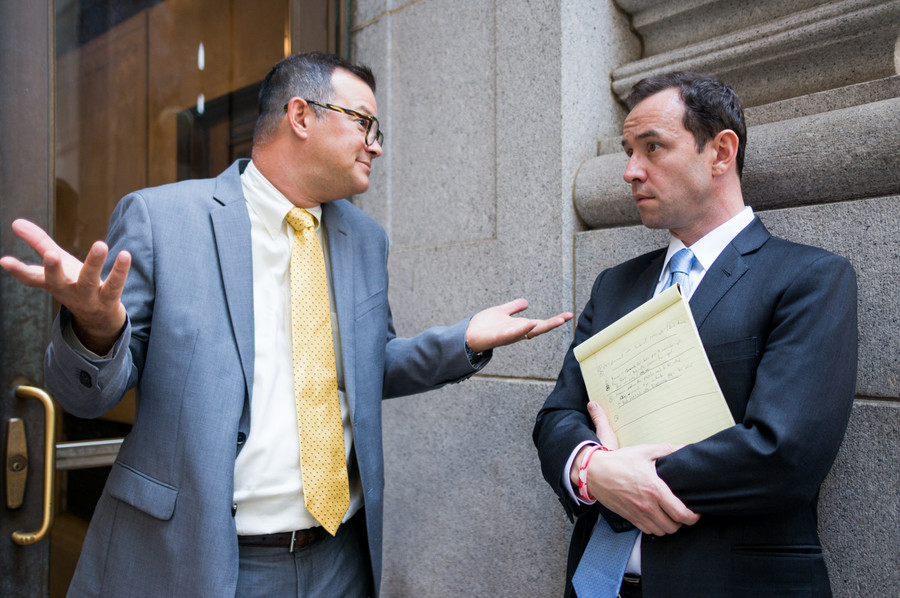 Councilman Andrew Cohen talks with CB8 member Dan Padernacht after a public hearing on the proposed deal with Stagg Group.