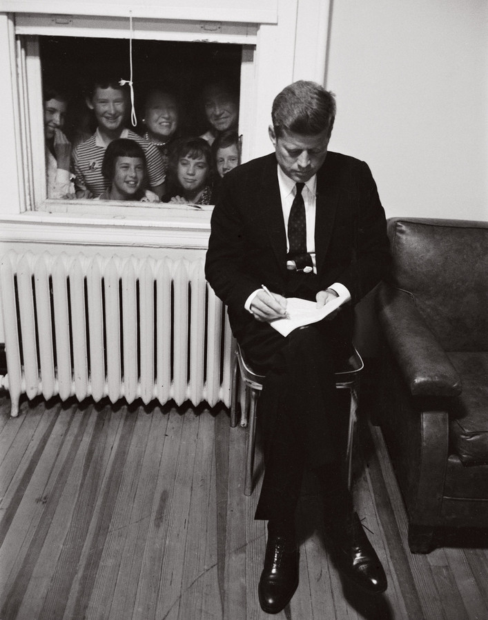 John Kennedy draws an unintended audience while preparing a speech in Baltimore in September 1960 during his presidential campaign. It is one of the many images shown in the exhibition 'American Visionary: John F. Kennedy's Life and Times,' which shows public and private moments of the president's life.