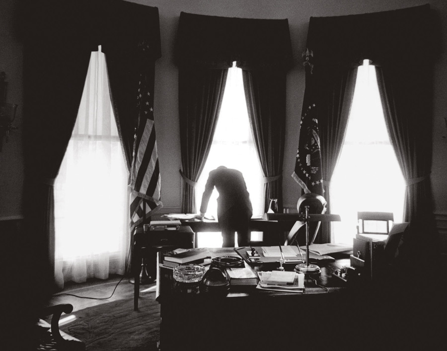 As captured by many photographers during his tenure in the White House, John F. Kennedy — photographed in 1961 — often stood hunched over his desk rather than seated to alleviate the pain from his back. The photo exhibition 'American Visionary: John F. Kennedy's Life and Times' at the New-York Historical Society, shows iconic and rare images of the 35th president.