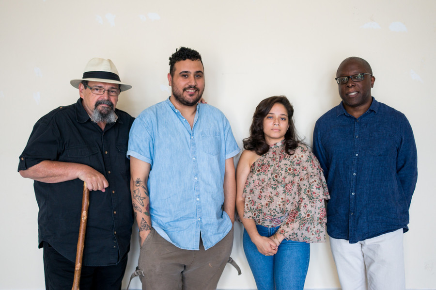 Bill Aguado, Oscar Rivera, Layza Garcia and Ron Kavanaugh stand in the Andrew Freedman Home where the Urban Arts Cooperative and En Foco are based. The four are just some of the faces backing an effort to help artists sustain financial stability and success.