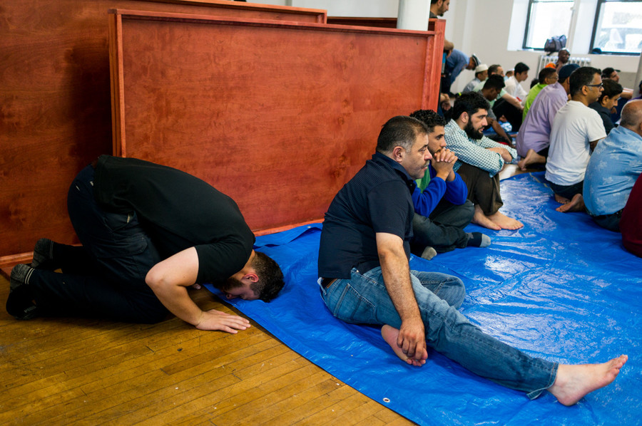 Members of the Abrar, a community of Muslims in Kingsbridge, pray in a space at the Episcopal Church of the Mediator. More than 150 faithful filled the space Aug. 25 to partake in weekly jumah prayer.