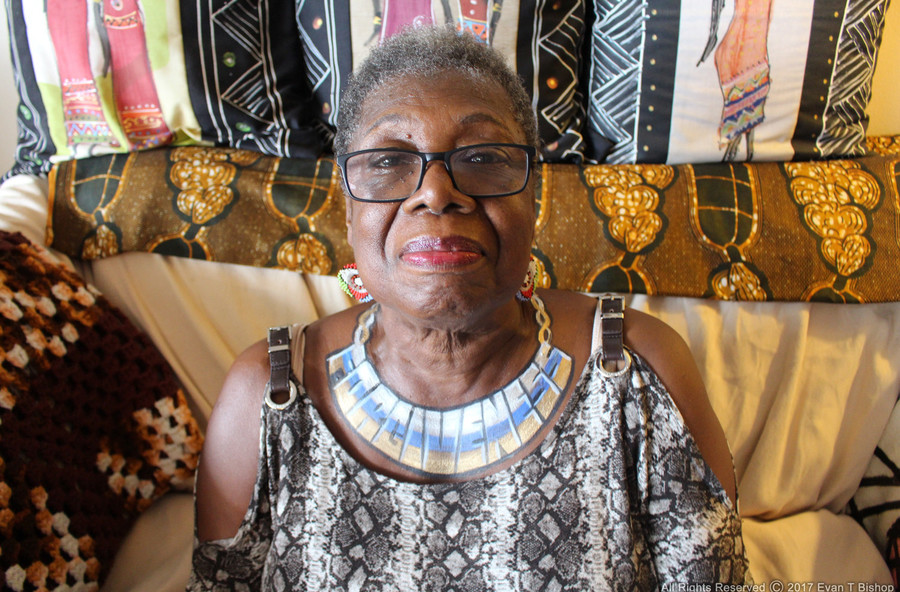 'Forgiveness' graces a necklace painted on Deloris Lee, 76. 'Forgiveness frees individuals,' she says. Don't 'allow disappointment and hate to build.'