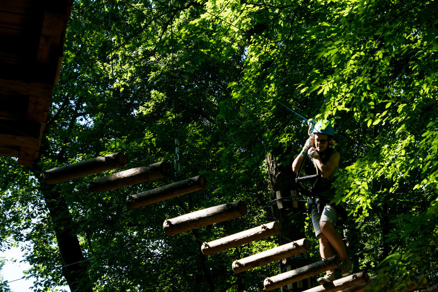 Inga Reznik walks across a bridge in the Bronx Zoo's Treetop Adventure.