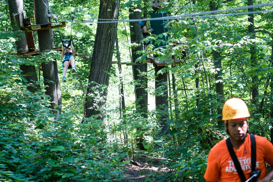 Emma Gelman slides down the zip line in the Bronx Zoo's Treetop Adventure.