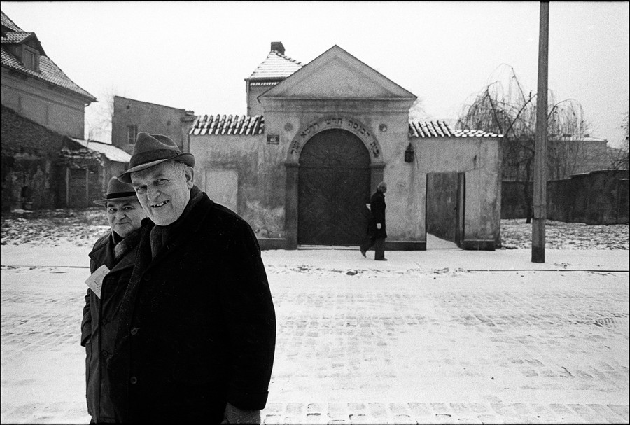 Two men in Krakow, Poland, leave a synagogue in December 1978 as part of photographer Chuck Fishman's new exhibit, 'Chuck Fishman: Roots, Resilience and Renewal — A Portrait of Polish Jews, 1975–2016,' at the Derfner Judaica Museum + The Art Collection at the Hebrew Home at Riverdale.