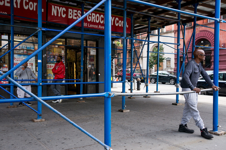 The scaffolding at 260 Lenox Avenue is a popular meeting spot.