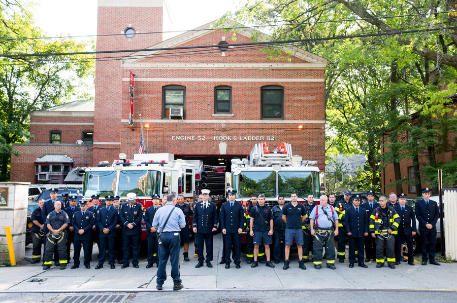 FDNY members with Ladder 52 stand for a moment of silence for the lives lost on Sept. 11, 2001.