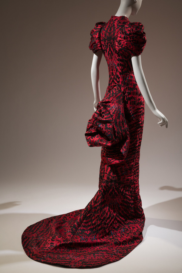 This garment comes from British designer Alexander McQueen's 2009's 'Horn of Plenty' collection. It is part of 'The Science of Attraction' section of the 'Force of Nature' exhibition at The Museum at Fashion Institute of Technology. 'McQueen loved birds and often tried to transpose the beauty of a bird on to the women he dressed,' says Melissa Marra, the museum's associate curator of education.