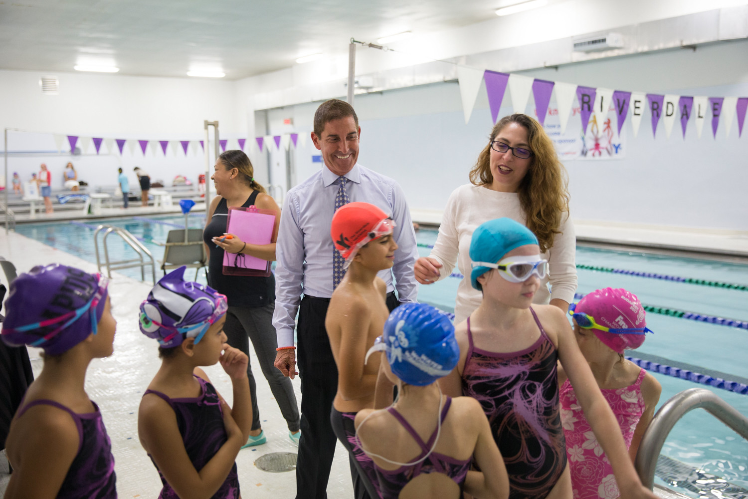 Sen. Jeffrey Klein meets with participants of The Riverdale Y's swim team to announce the allocation of $115,000 to help renovate its pool.