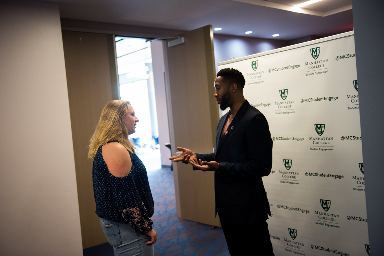 Ndaba Mandela, the grandson of Nelson Mandela, talks with a student following his talk at Manhattan College.