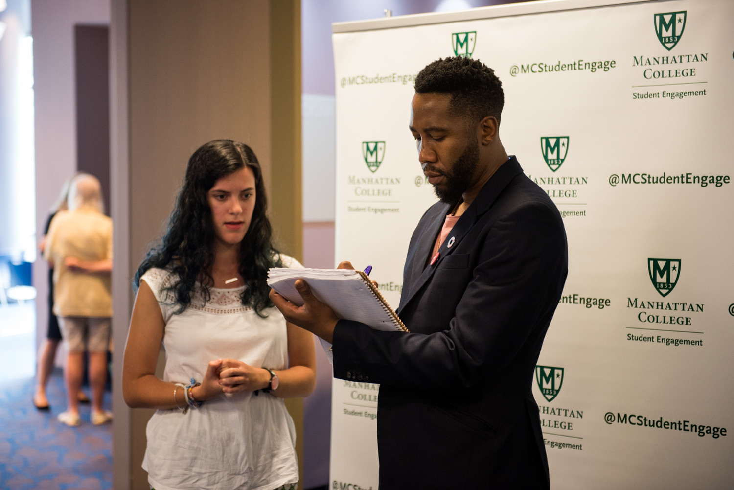 Ndaba Mandela, the grandson of Nelson Mandela, signs an autograph following his talk at Manhattan College.