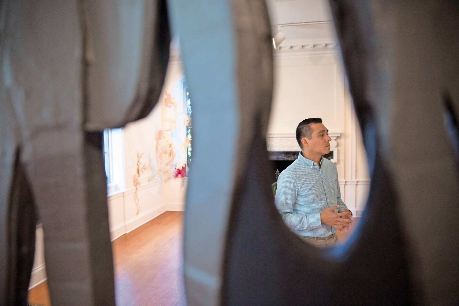 Standing behind an installation by artist Amie Cunat, Gabriel de Guzman — Wave Hill's Glyndor Gallery curator — talks about garden-related works created by New York artists for the Sunroom Project Space's 10th anniversary 'Call & Response' exhibition.