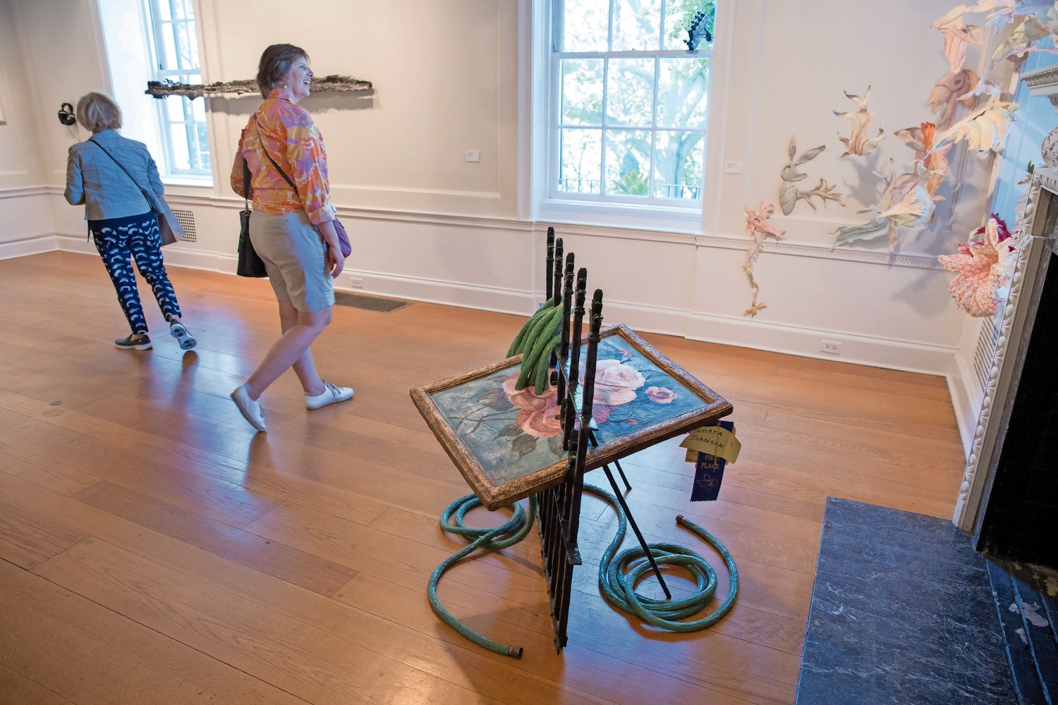 Wave Hill visitors look at works in the Glyndor Gallery. The exhibition, featuring 50 alumni artists, celebrates the 10th anniversary of the Sunroom Project Space, which invites local artists to create work related to Wave Hill. The exhibit, 'Call & Response' runs through Dec. 3.