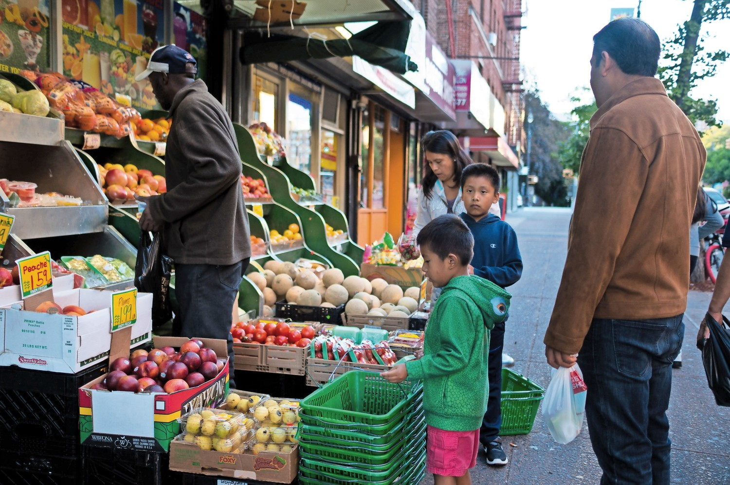 A family peruses the produce selection at California Farms, a popular store on West 231st Street owned by a Mexican-American family.