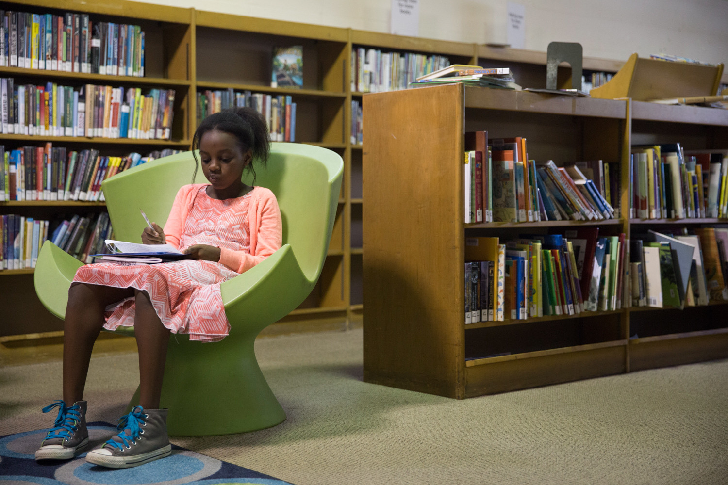 Hadasah Ndegwa, fifth-grader at P.S. 81 Robert Christen, does homework at the library.