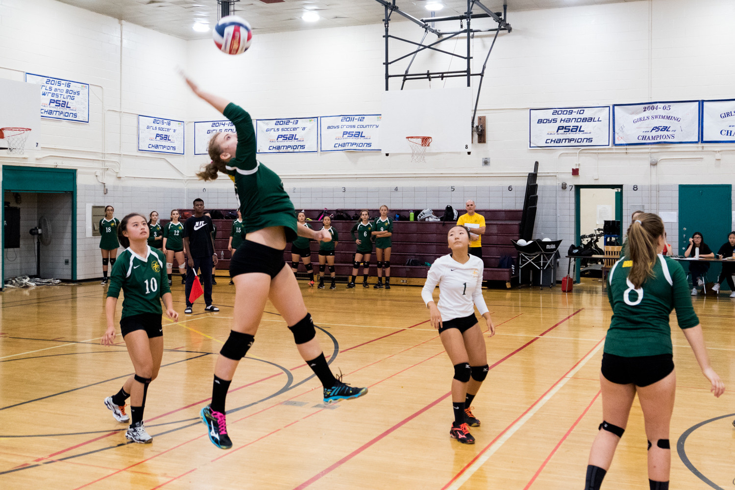 Bronx Science's Kateryna Slinchenkova unleashes one of her eight kills in the Wolverines' straight-set victory over neighborhood-rival Clinton last week. Science now has won 39 straight regular-season matches.