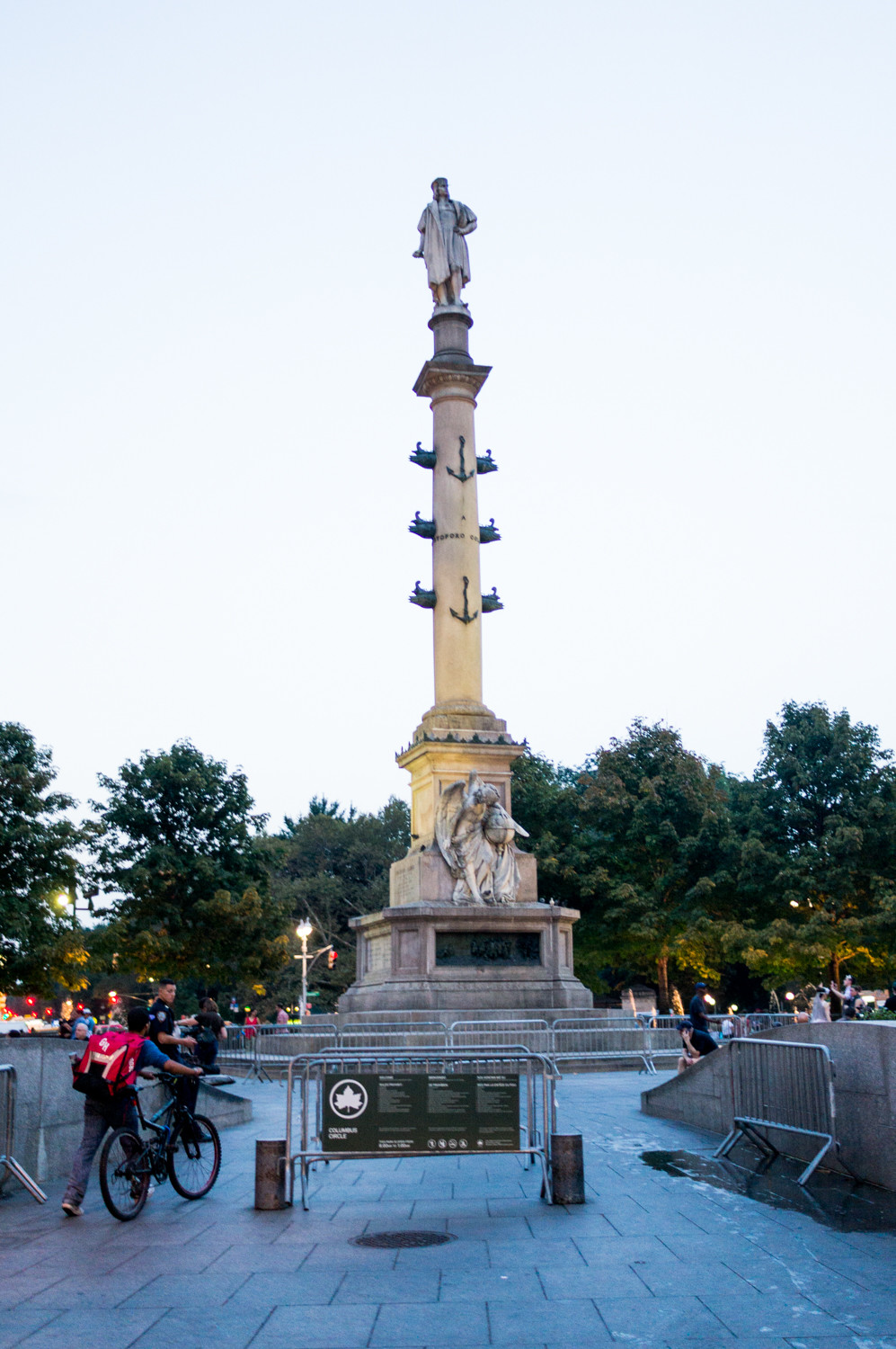 Police officers and barricades guard the statue of Christopher Columbus in Manhattan's Columbus Circle ahead of Columbus Day.
