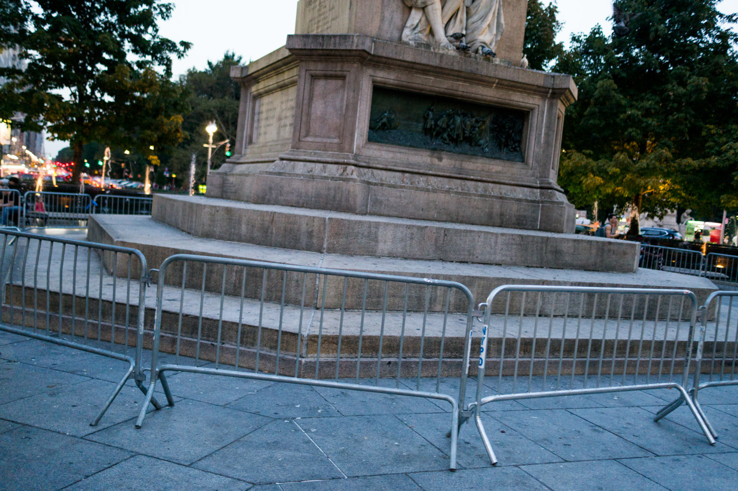 Barricades prevent people from accessing the base of the statue of Christopher Columbus in Manhattan, a popular spot for taking a breather.