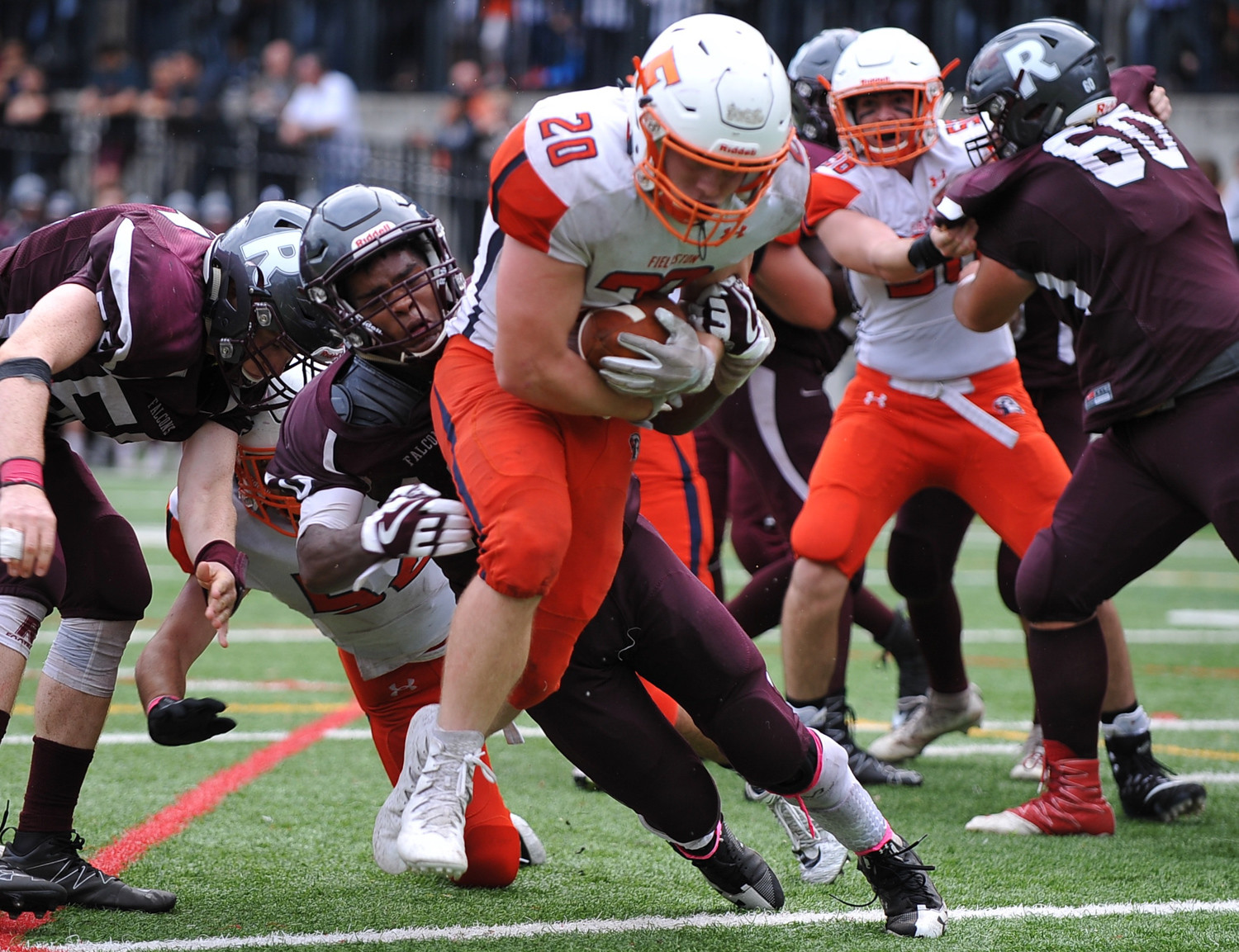 Fieldston's Josh Godosky, shown here ripping off a big gainer versus Riverdale, scored one touchdown and anchored a solid defensive effort from his linebacker spot in the Eagles' victory of the Falcons.