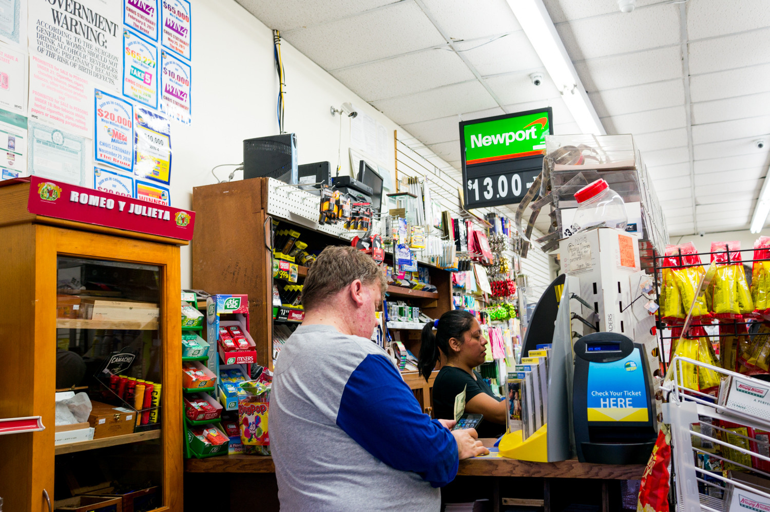 A customer purchases lotto tickets at Larry's Lucky Lotto.