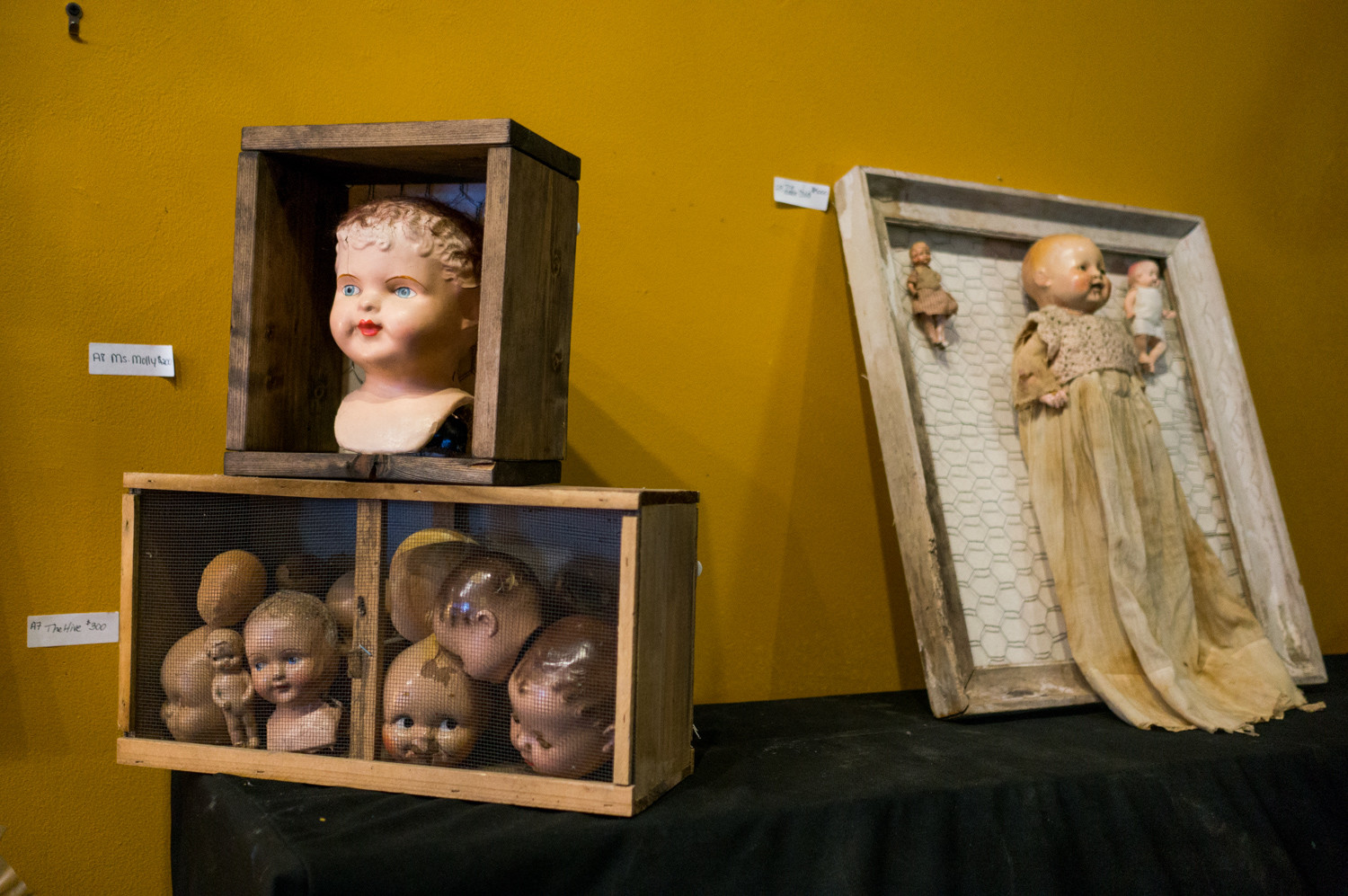 The Creepy Baby Project is a mix of photographs and objects.