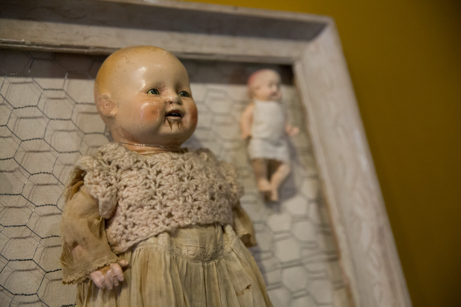 A detail of a piece featured at the Creepy Baby exhibit at An Beal Bocht Cafe.