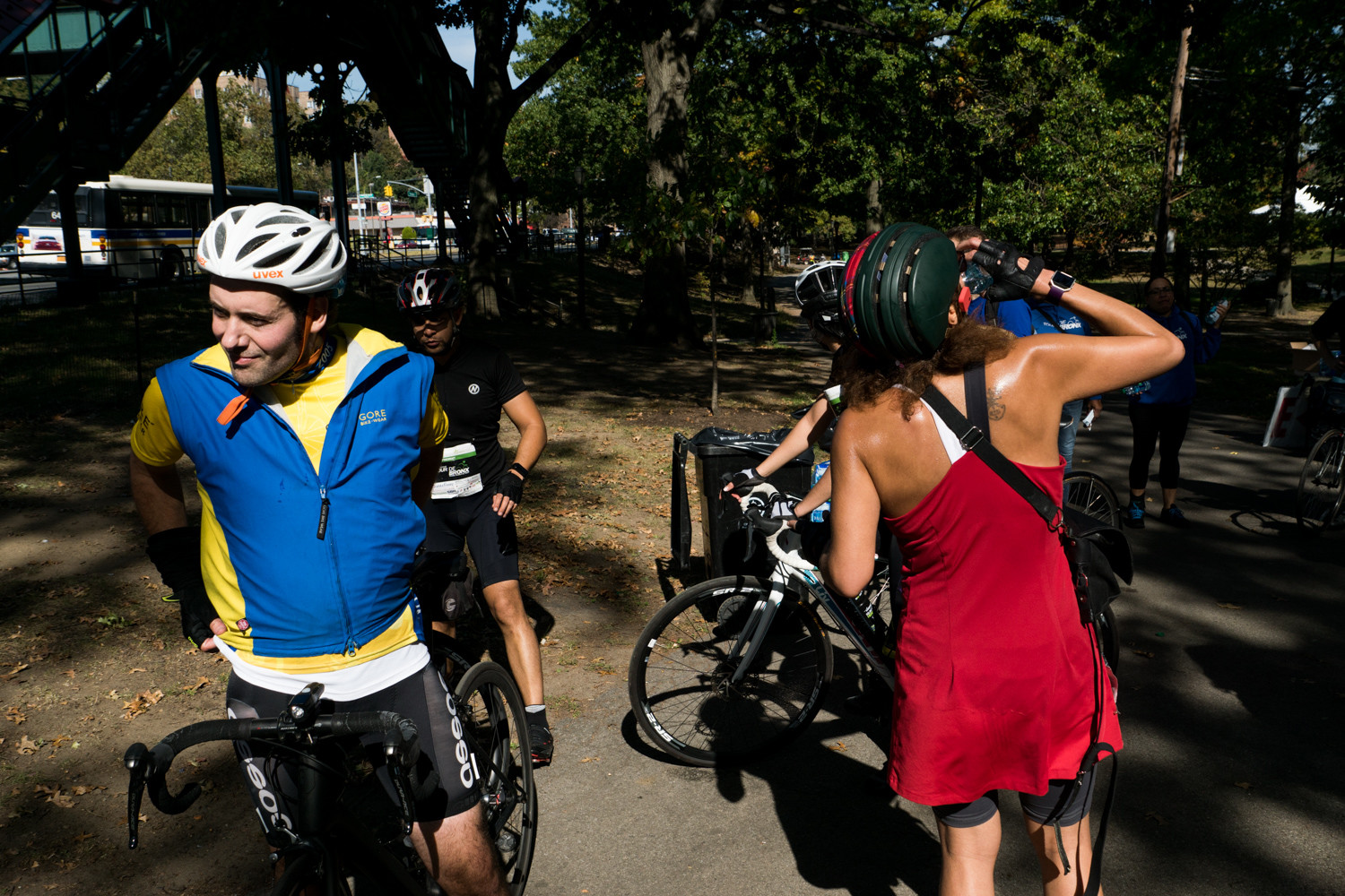 Cyclists rest briefly in Van Cortlandt Park near Broadway along the Tour de Bronx's extended 40-mile route.