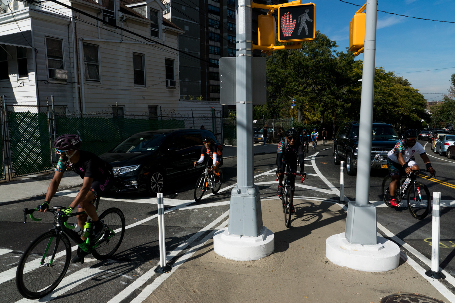 Cyclists work their way up Fort Independence Street in the Tour de Bronx's extended 40-mile route.