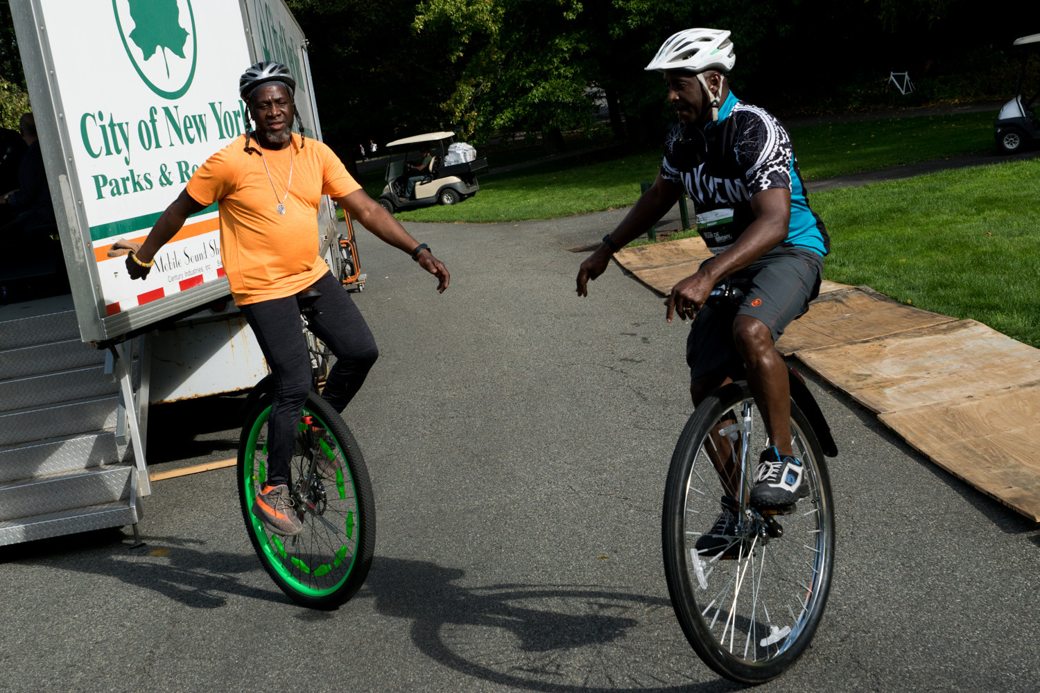 Ken Springle, right, and Abdul Wright ride their unicycles at the end of the Tour de Bronx. Springle and Wright are members of the New York Unicycle Club. Both Springle and Wright rode the 25-mile route.