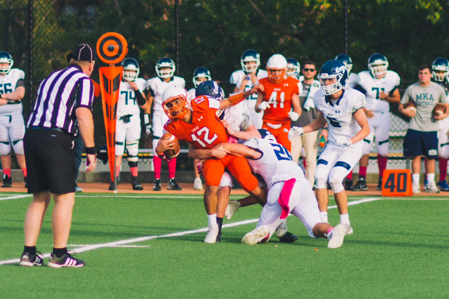 Fieldston quarterback Jesse Cooper-Leary (12), who threw for a touchdown, picks up a few yards on a scramble during the Eagles' convincing victory over Montclair Kimberley Academy.