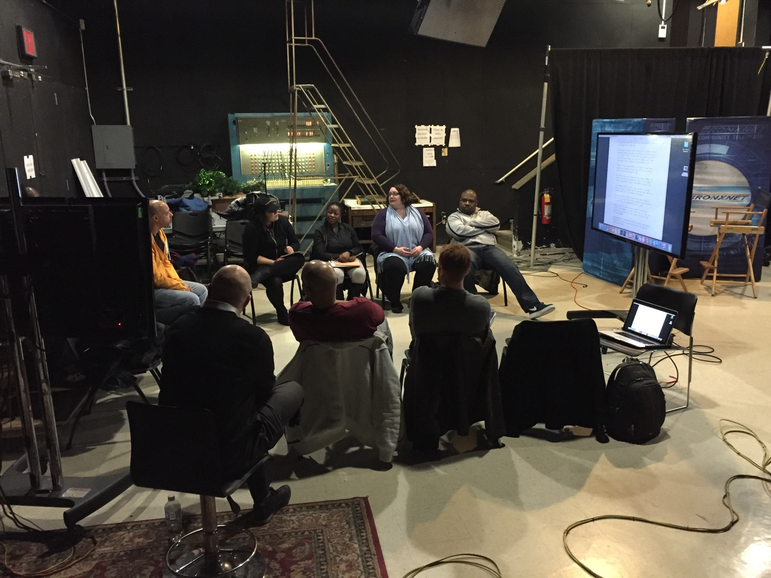 Members of The Bronx Filmmakers Collective conduct a monthly meeting inside BronxNet's studio at Lehman College.
