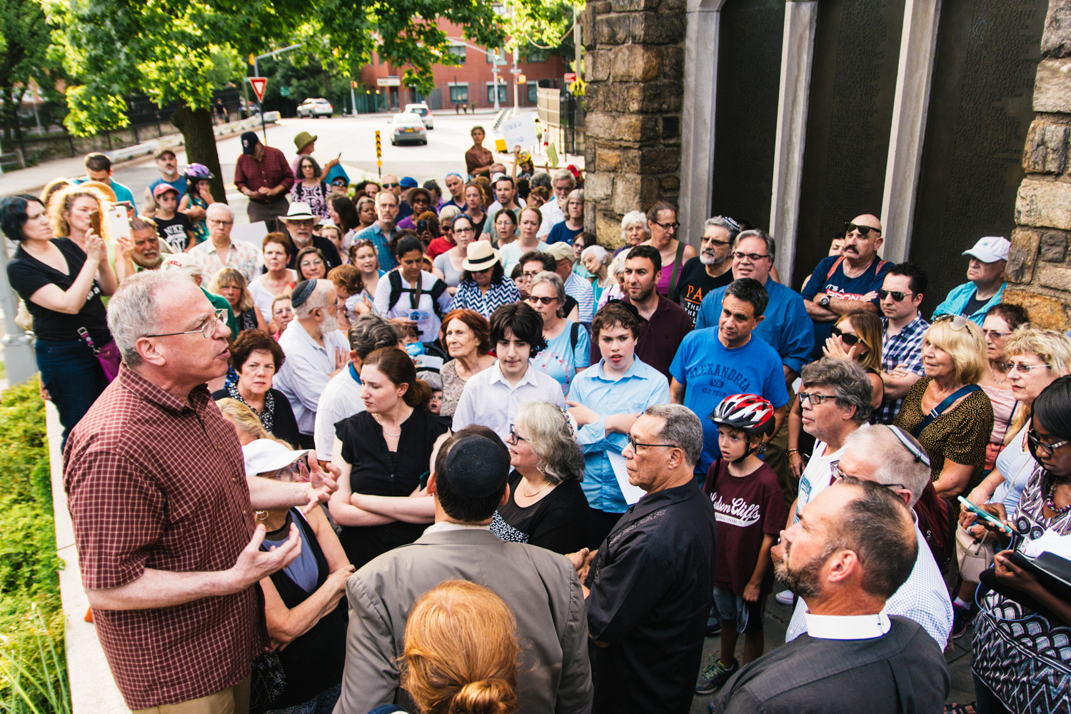 Assemblyman Jeffrey Dinowitz speaks to community members at a peace rally following the violent clashes in Charlottesville, VA.